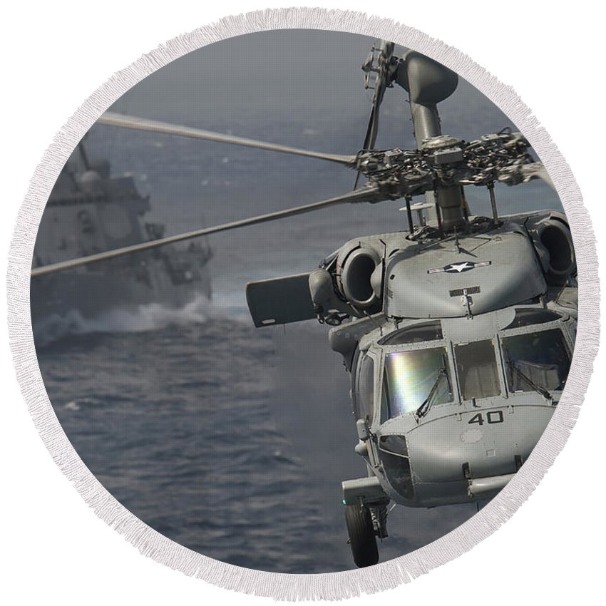 No People Round Beach Towel featuring the photograph N Mh-60s Knight Hawk Delivers Supplies by Stocktrek Images