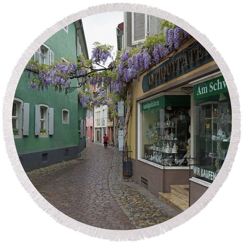 Freiburg Germany Round Beach Towel featuring the photograph Narrow Street In Freiburg by Robert VanDerWal