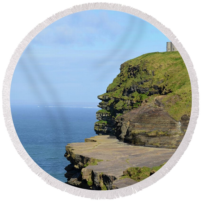 O'brien's-tower Round Beach Towel featuring the photograph O'brien's Tower Along The Cliff's Of Moher In Ireland by DejaVu Designs