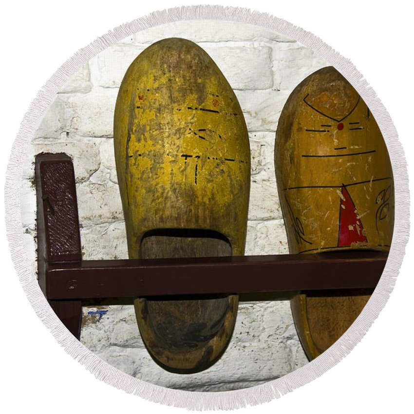 Old Wooden Shoes Round Beach Towel featuring the photograph Old Dutch Wooden Shoes by Sally Weigand