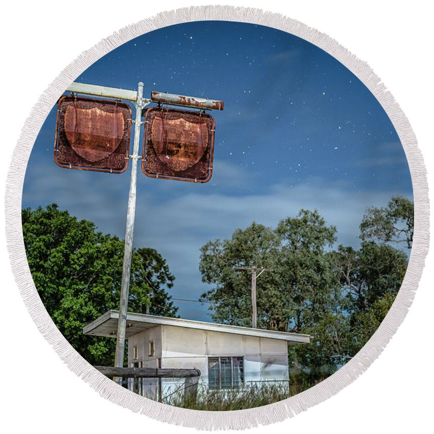 Gas Round Beach Towel featuring the photograph Old Rustic Fuel Station Sign In The Countryside by Rob D