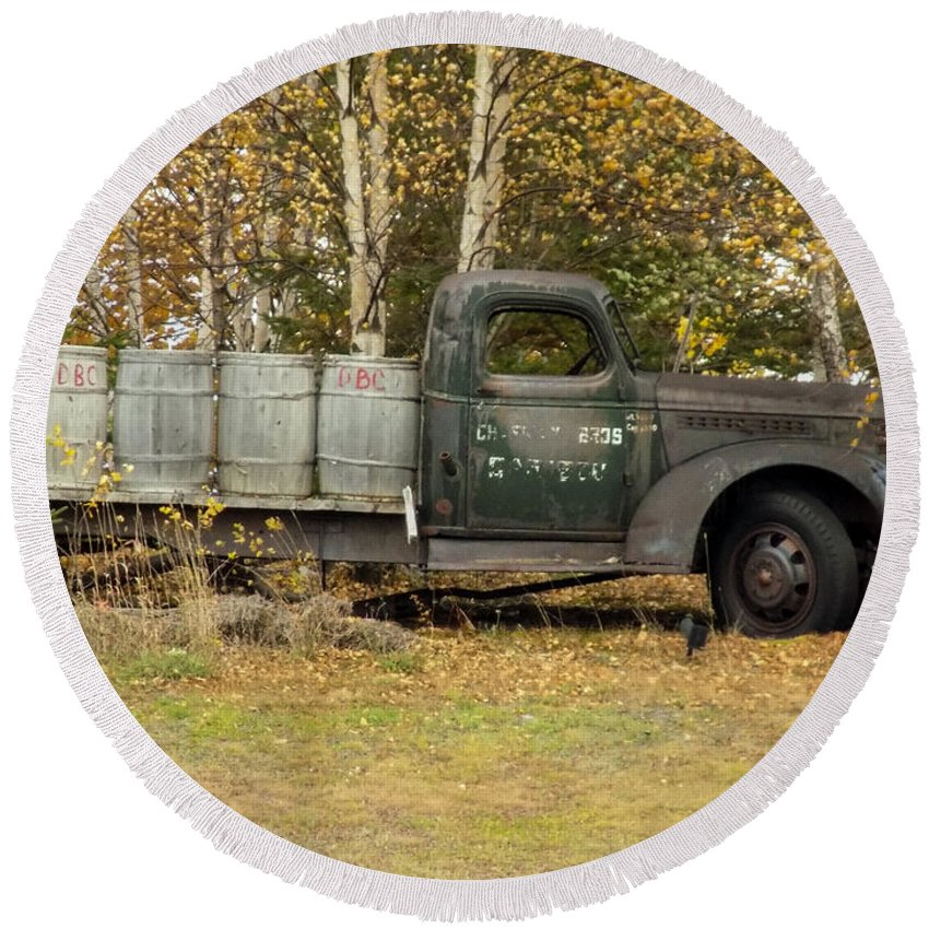 Potato Barrels Round Beach Towel featuring the photograph Old Truck With Potato Barrels by William Tasker