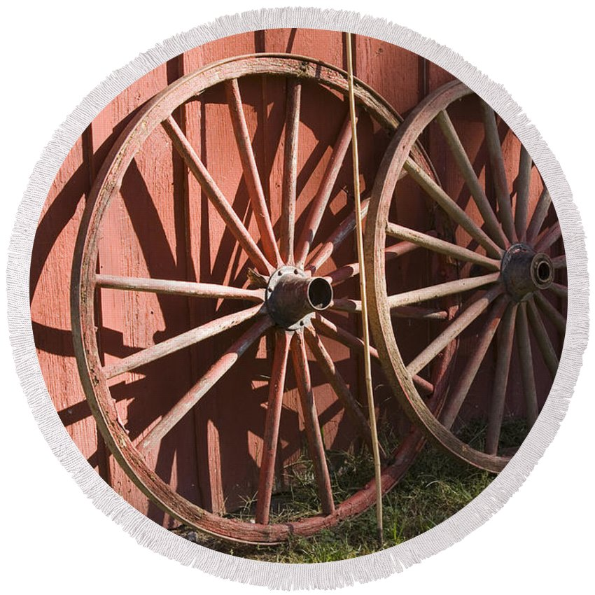 Old Time Antique Wagon Wheel Wood Wooden Red Barn Rural Country Farm Farming Round Round Beach Towel featuring the photograph Old Wagon Wheels by Andrei Shliakhau