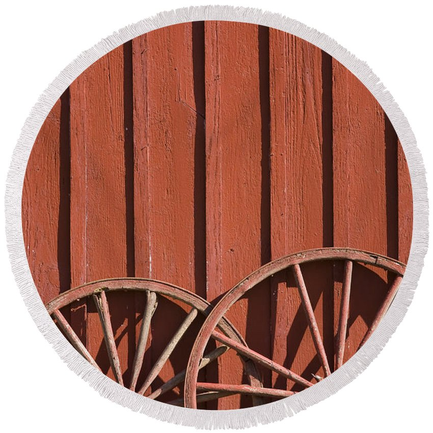 Wheel Wheels Wagon Old Red Barn Antique Past History Rural Country Round Beach Towel featuring the photograph Old Wagon Wheels IIi by Andrei Shliakhau