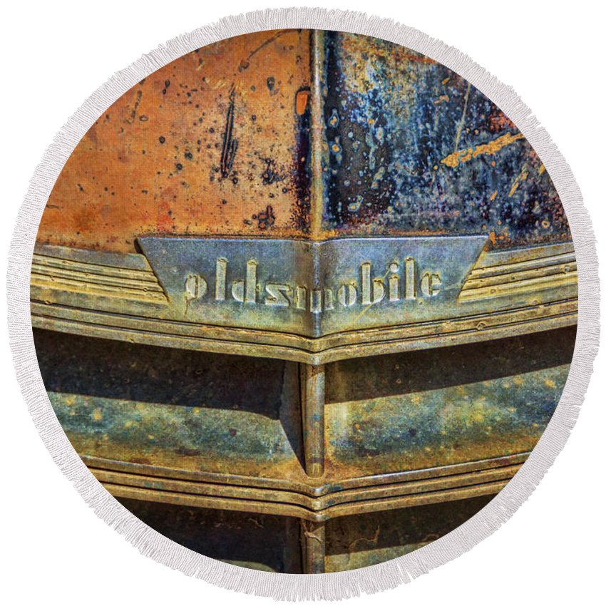 Abandoned Round Beach Towel featuring the photograph Oldsmobile by Janice Pariza