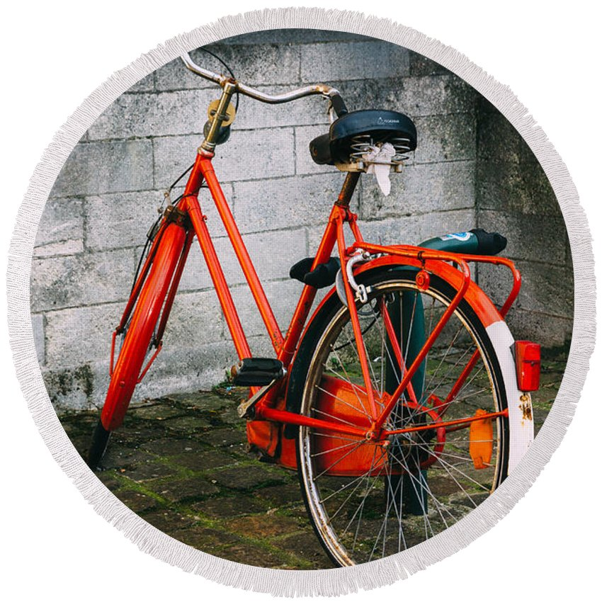 Orange Round Beach Towel featuring the photograph Orange Bicycle In The Street by Pati Photography