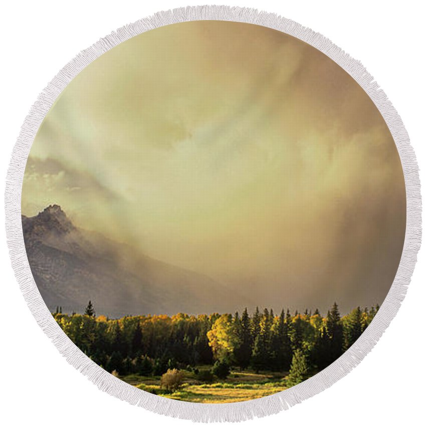 North America Round Beach Towel featuring the photograph Panorama Clearing Storm Over The Grand Tetons by Dave Welling