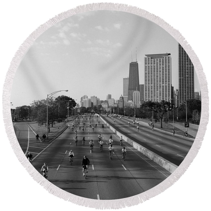 Photography Round Beach Towel featuring the photograph People Cycling On A Road, Bike The by Panoramic Images