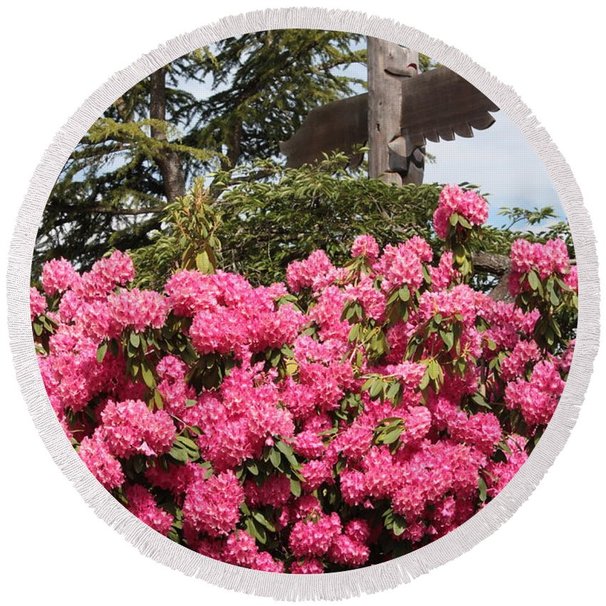 Northwest Round Beach Towel featuring the photograph Pink Rhododendrons With Totem Pole by Carol Groenen