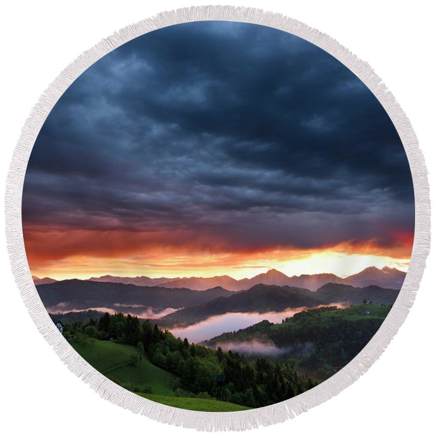 Sunrise Round Beach Towel featuring the photograph Pink Sunrise And Blue Clouds In The Mountains Of Kamnik Savinja by Reimar Gaertner