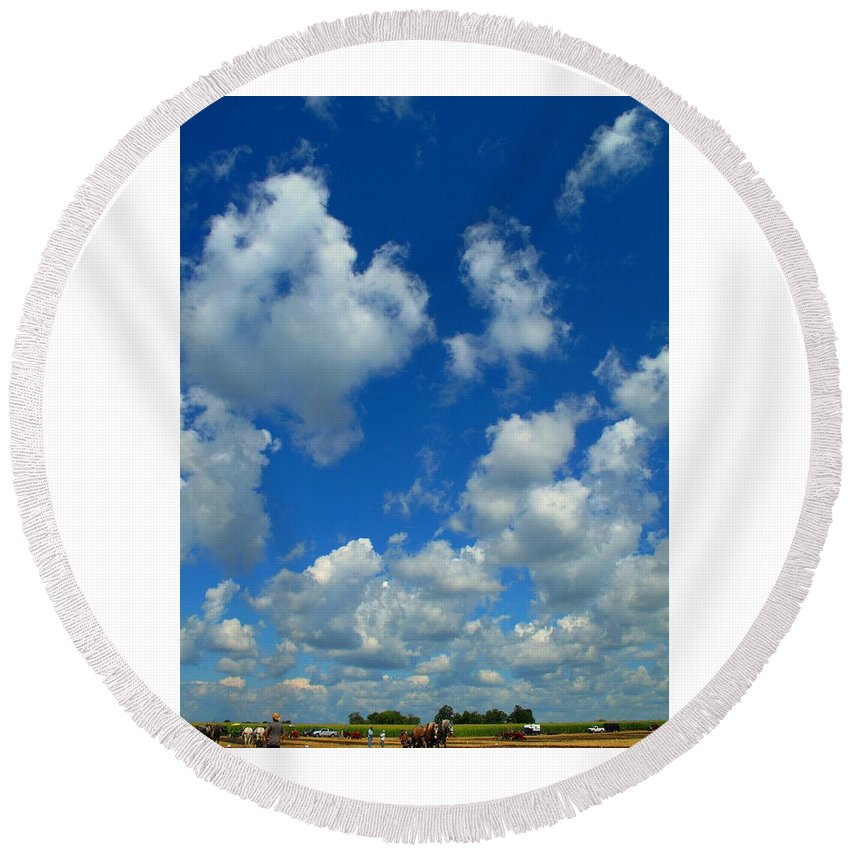 Clouds Round Beach Towel featuring the photograph Ploughing Under A Mid Day Sun by Ian MacDonald