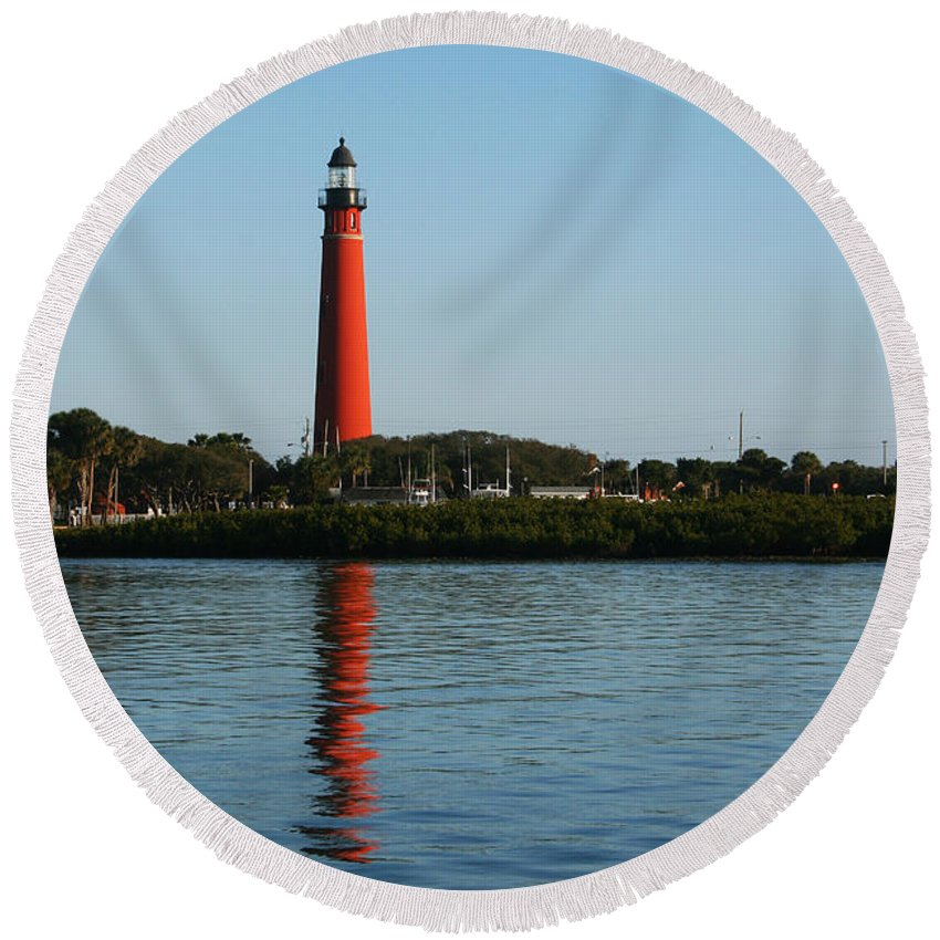 Lighthouse Tall Red Water Reflection Fl Sky Blue Wave Ripple Inlet Travel Tourist Vacation Round Beach Towel featuring the photograph Ponce Inlet Lighthouse by Andrei Shliakhau