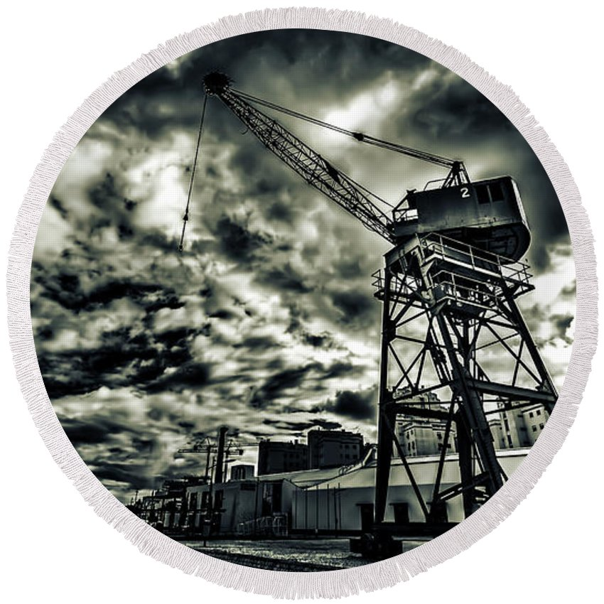 Port Round Beach Towel featuring the photograph Port Crane At Dusk by Ddzphoto