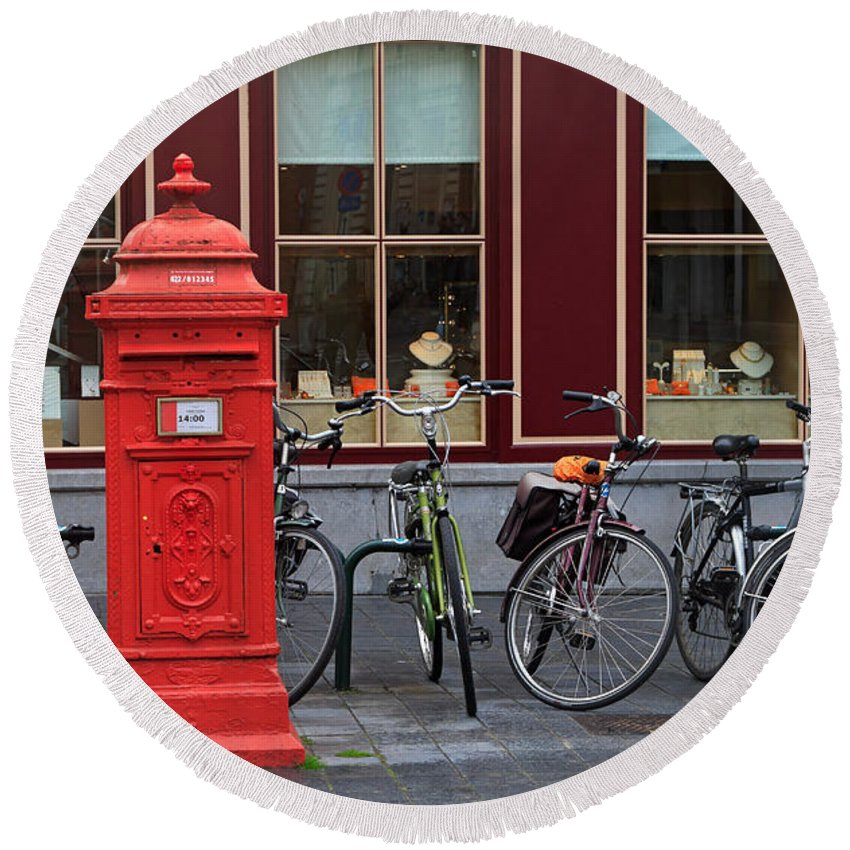 Postbox Round Beach Towel featuring the photograph Postbox And Bicycles In Front Of The Diamond Museum In Bruges by Louise Heusinkveld