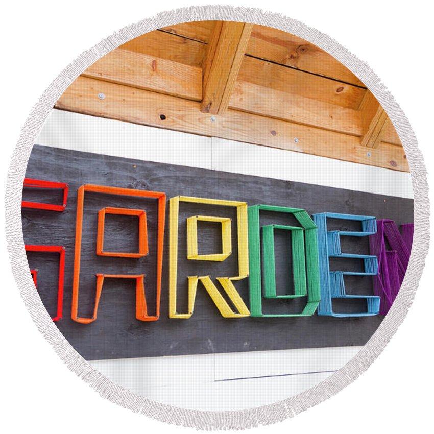 Round Beach Towel featuring the photograph Rainbow Garden Sign One by Sara Schroeder