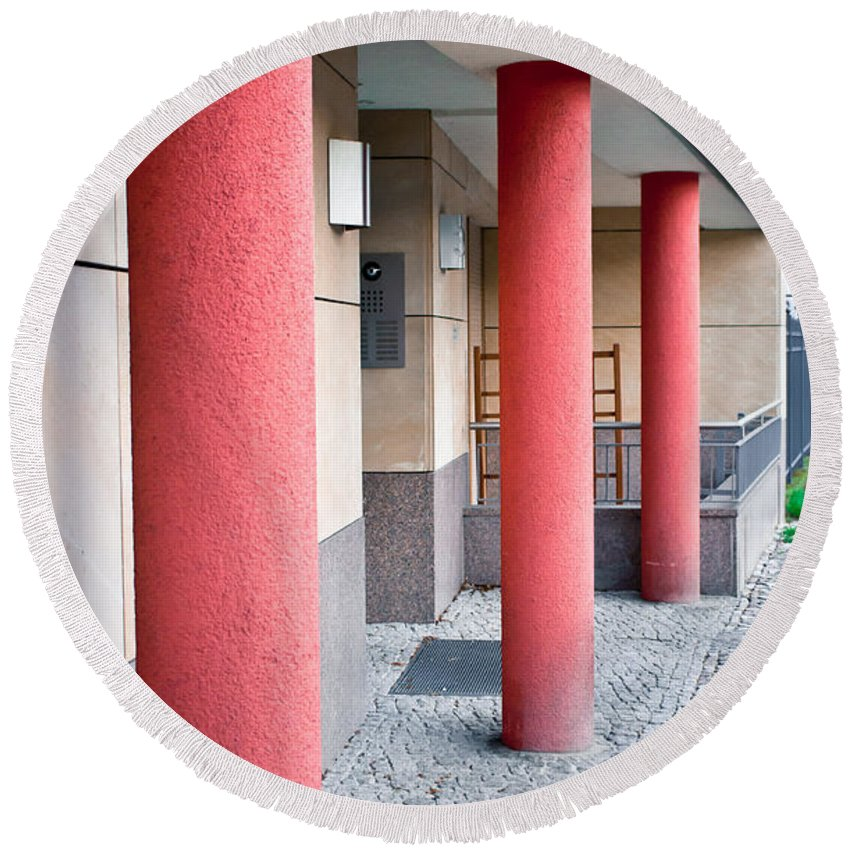 Abstract Round Beach Towel featuring the photograph Red Pillars by Tom Gowanlock