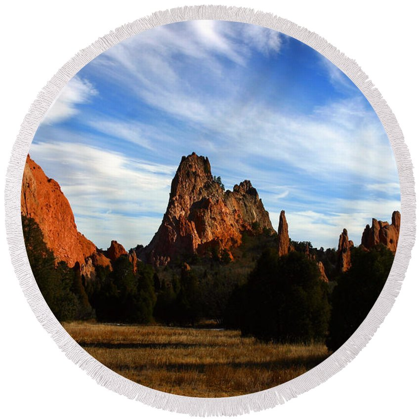 Garden Of The Gods Round Beach Towel featuring the photograph Red Rock Formations by Anthony Jones