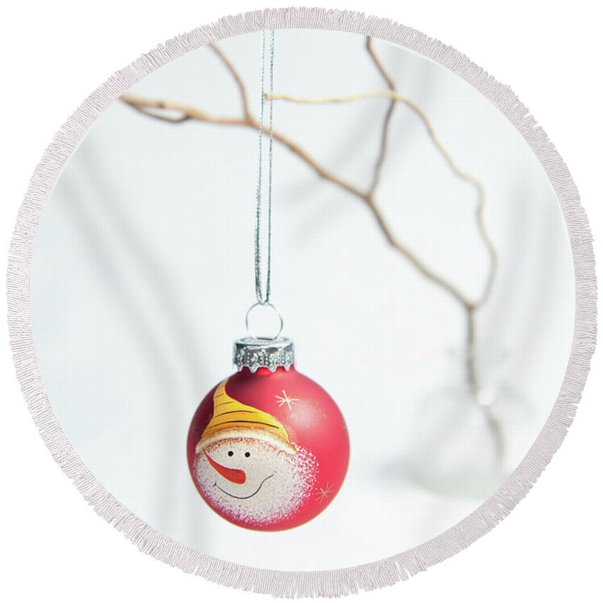 Helen Northcott Round Beach Towel featuring the photograph Red Snowman Bauble On A Branch by Helen Northcott