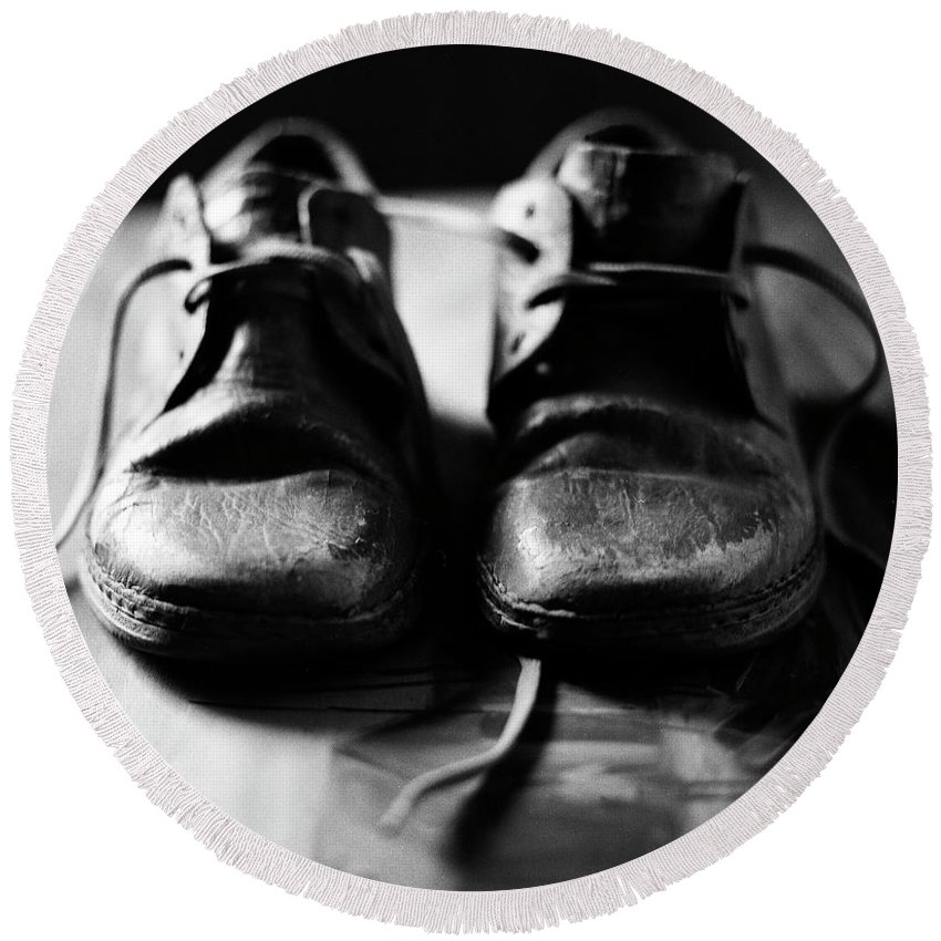 Old Shoes Round Beach Towel featuring the photograph Retired Old Shoes by Muyiwa OSIFUYE