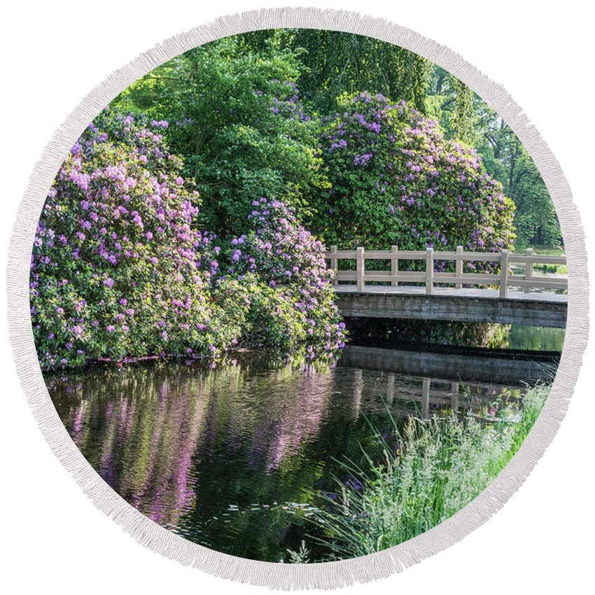 Purple Round Beach Towel featuring the photograph Rhododendrons And Wooden Bridge In Park by Compuinfoto