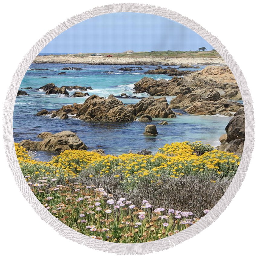 Ocean Round Beach Towel featuring the photograph Rocky Surf With Wildflowers by Carol Groenen