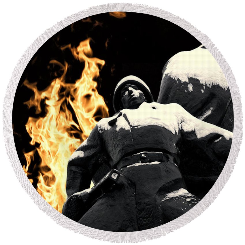 Soldier Statue Round Beach Towel featuring the photograph Russian Soldier Statue In Snow And Fire by John Williams