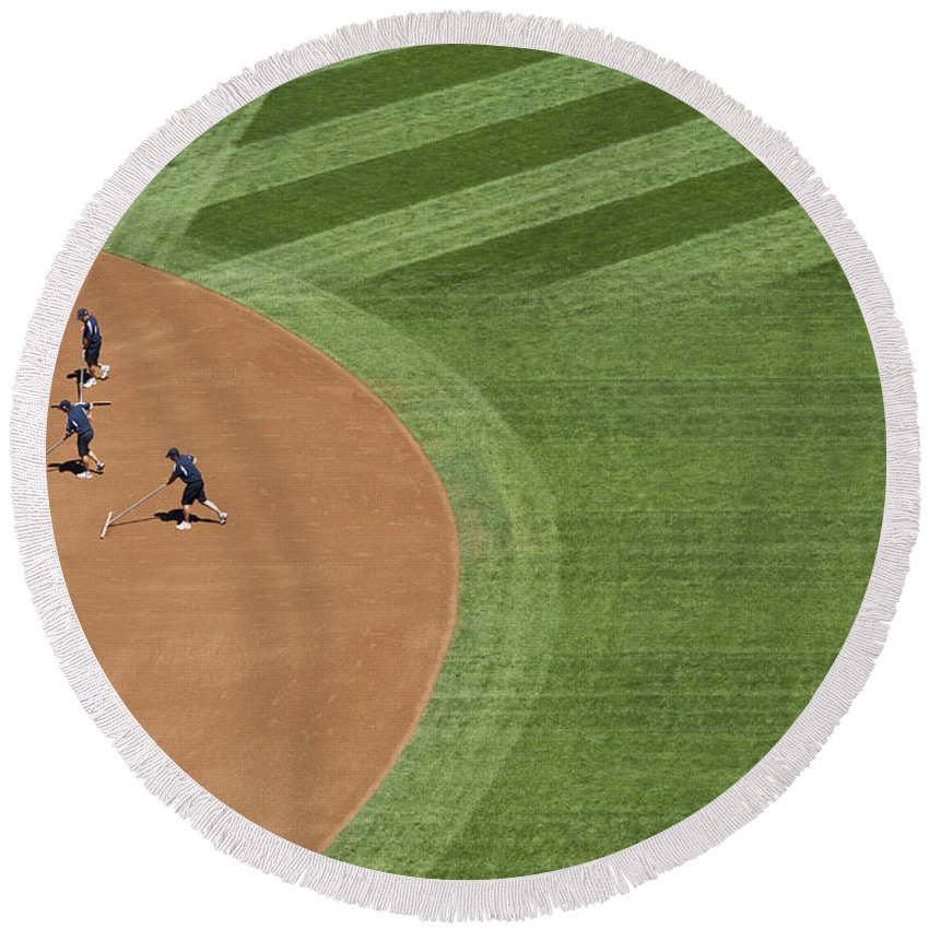 American Dream Round Beach Towel featuring the photograph Safeco Field Abstract Patterns With Ground Crew Preparing Field by Jim Corwin
