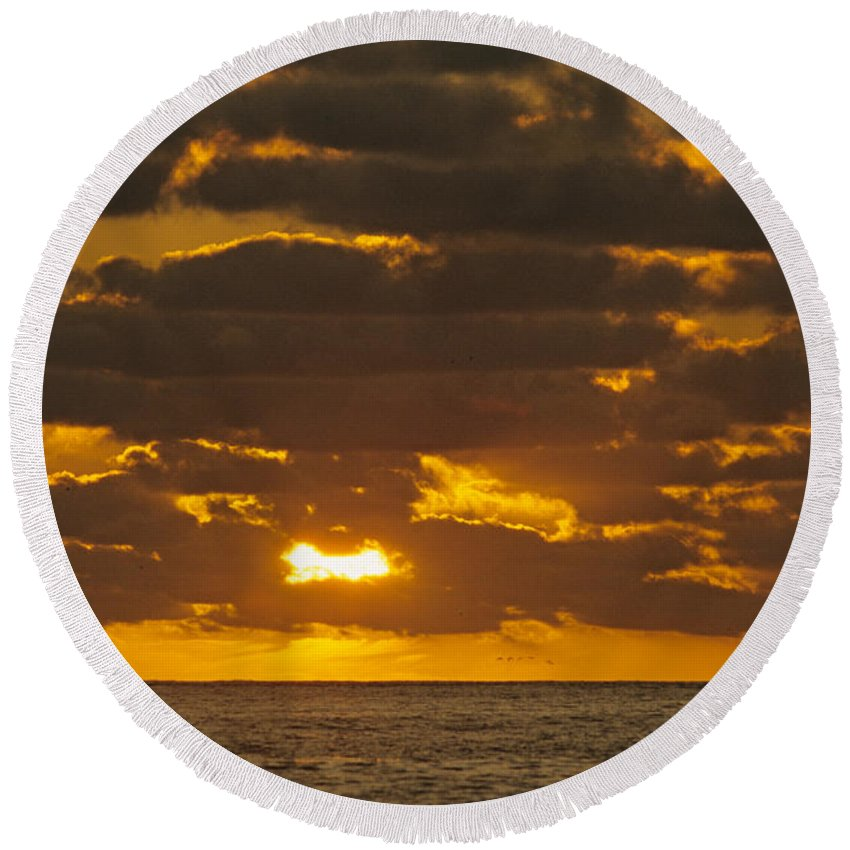 Sil Round Beach Towel featuring the photograph Sailboat As The Sun Sets by John Harmon