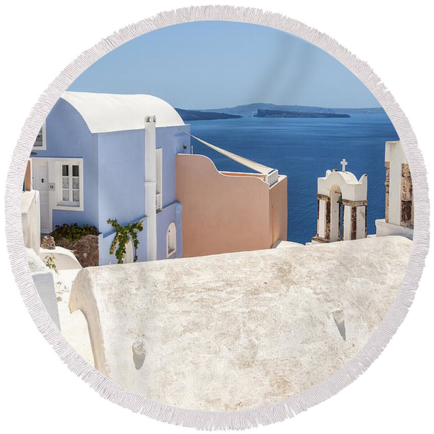 Santorini Round Beach Towel featuring the photograph Santorini Blue House In Oia by Antony McAulay