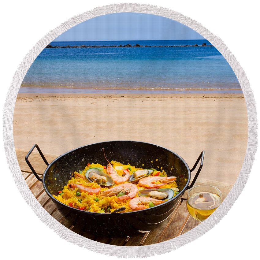 Paella Round Beach Towel featuring the photograph Seafood Paella In Cafe by Anastasy Yarmolovich