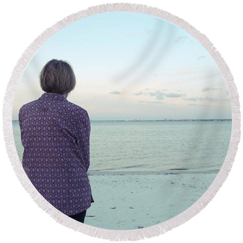 Florida Round Beach Towel featuring the photograph Senior Woman On The Beach by Edward Fielding