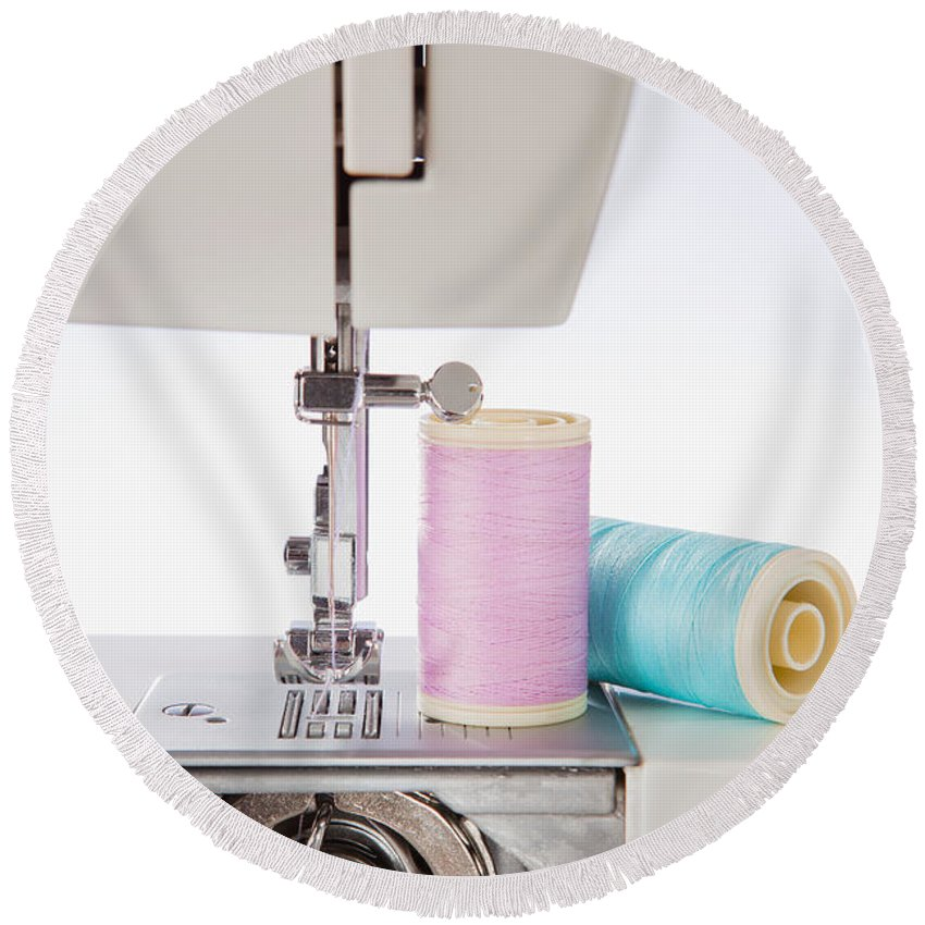 Sewing Machine Round Beach Towel featuring the photograph Sewing Threads In Pastel Colors And Detailed View Of A Sewing Machine by Wolfgang Steiner