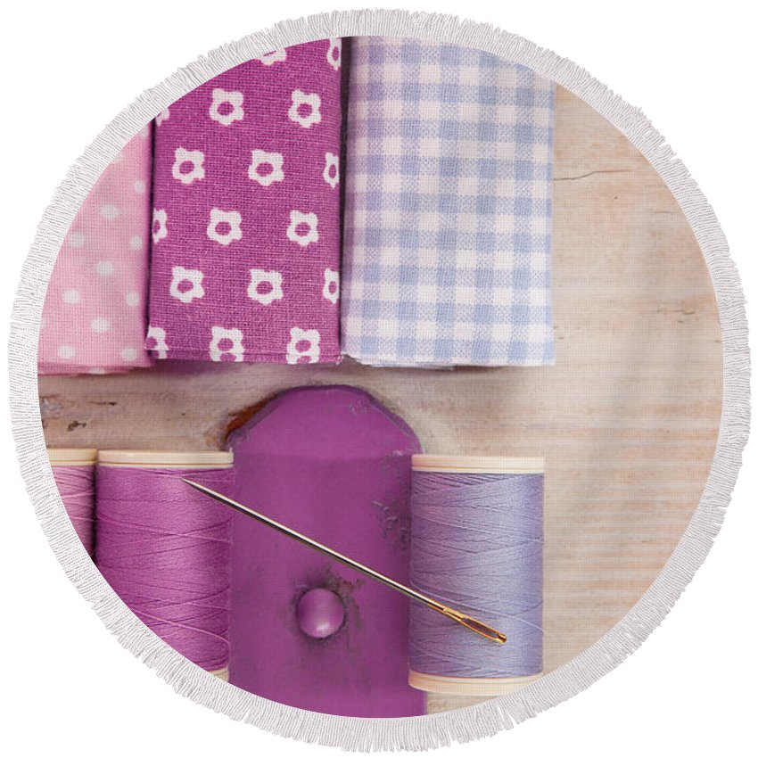 Crafts Round Beach Towel featuring the photograph Sewing Threads Needle And Fabrics On A Wooden Box by Wolfgang Steiner