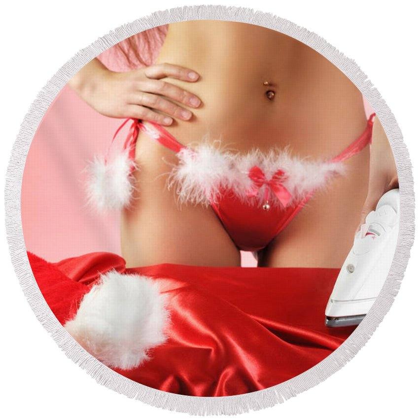 Christmas Round Beach Towel featuring the photograph Sexy Woman Preparing For Christmas Holidays by Maxim Images Prints
