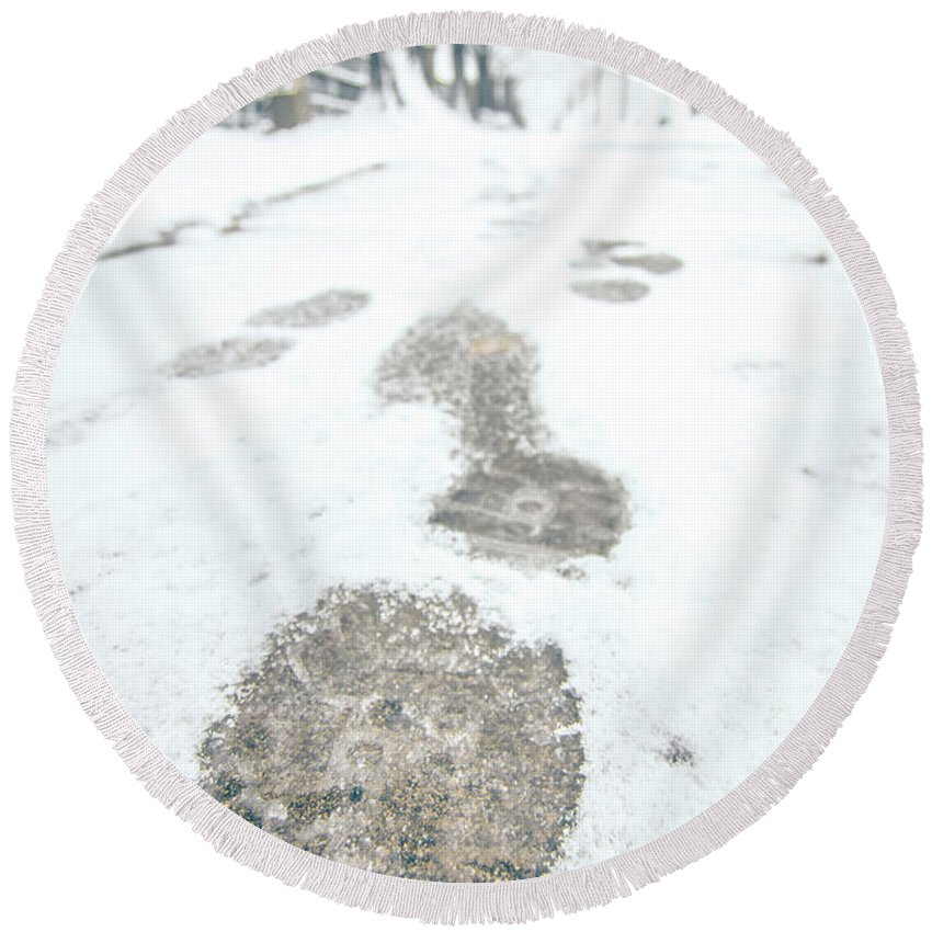 Foot Round Beach Towel featuring the photograph Show Footprints In Snow On Sidewalk Along The Park by Alex Grichenko
