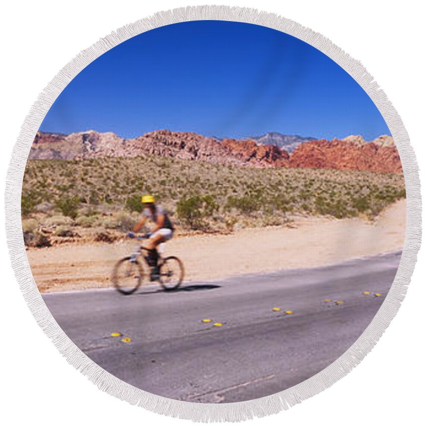 Photography Round Beach Towel featuring the photograph Side Profile Of A Person Cycling by Panoramic Images