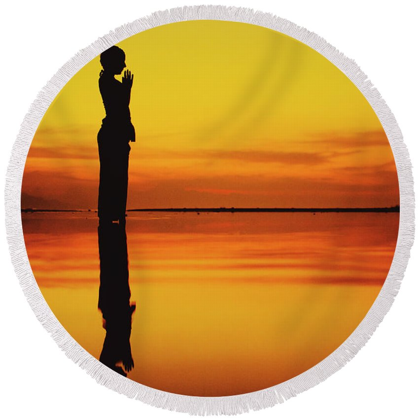 Asia Round Beach Towel featuring the photograph Silhouette Of A Girl Practicing Yoga Reflected On The Surface Of Water During Beautiful Sunset by Srdjan Kirtic