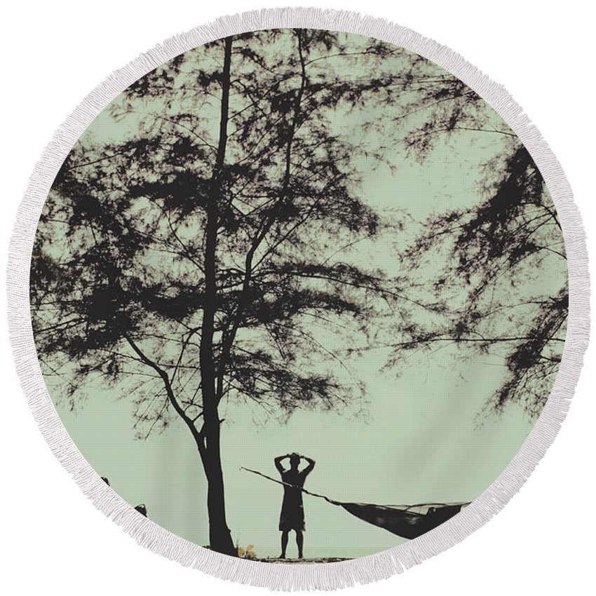 Adventure Round Beach Towel featuring the photograph Silhouette Of A Young Men With Crossed Hands Above His Head Camping Hammocking In The Nature by Srdjan Kirtic