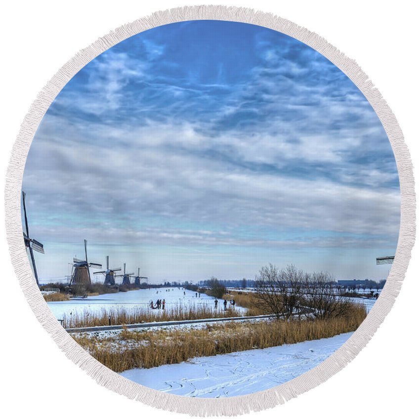 Winter Round Beach Towel featuring the photograph Skating Around The Windmills by Frans Blok