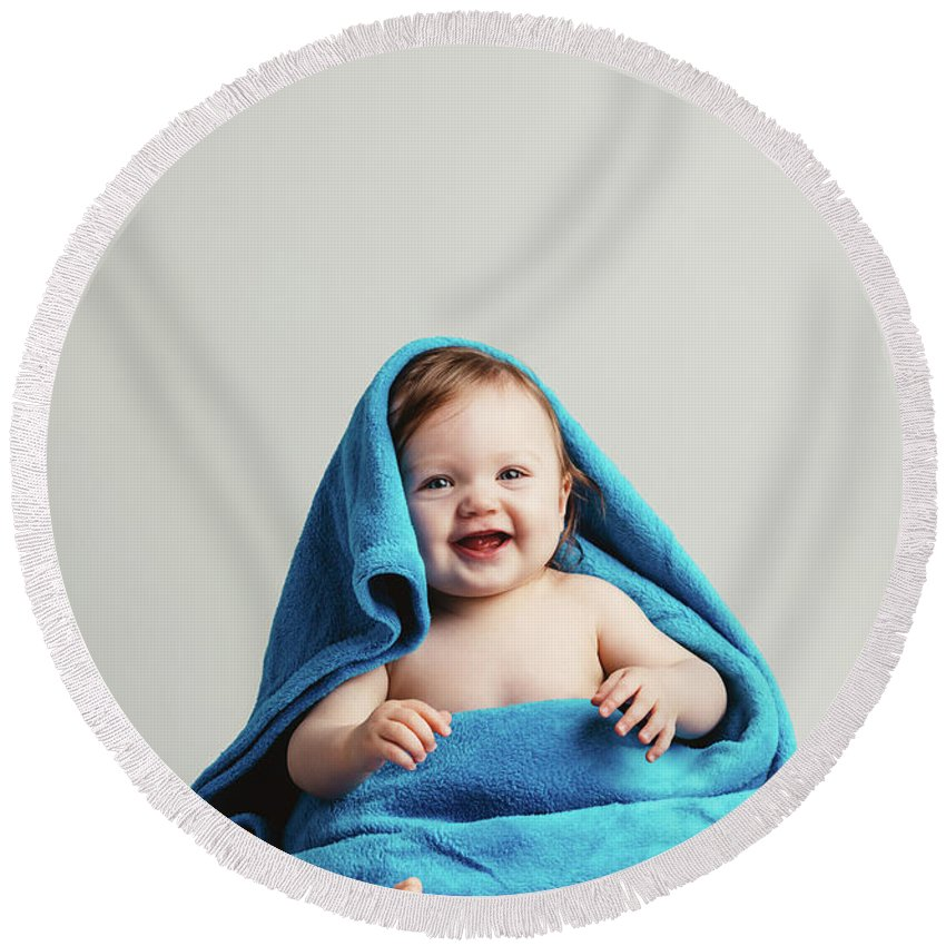 Baby Round Beach Towel featuring the photograph Smiling Baby Tucked In A Warm Blanket by Michal Bednarek
