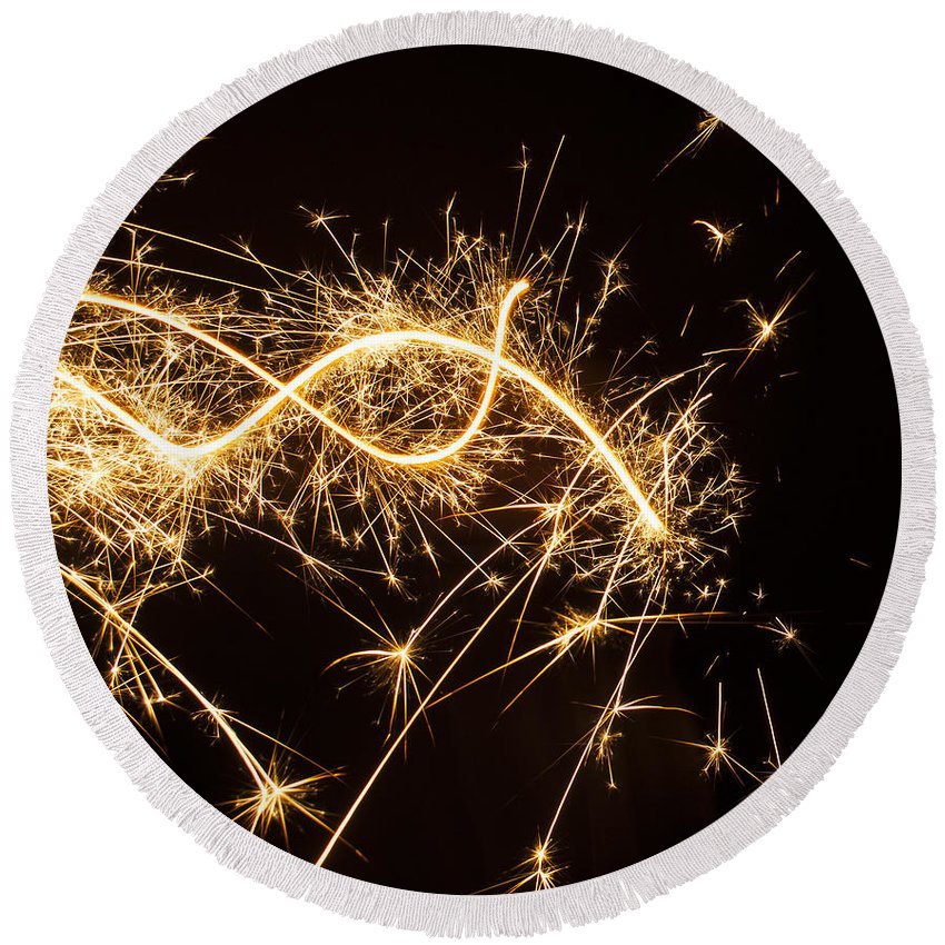 Celebrations Round Beach Towel featuring the photograph Sparkler In Christmas by Tamara Sushko