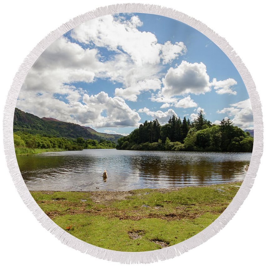 Cumbria Lake District Round Beach Towel featuring the photograph Spot The Swimming Dog In Derwnt Water Lake by Iordanis Pallikaras