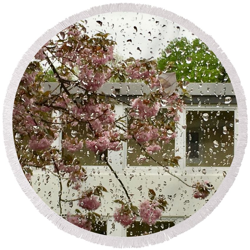 Spring Rain Outside The Window And Sakura By Marina Usmanskaya Round Beach Towel featuring the photograph Spring Rain Outside The Window And Sakura by Marina Usmanskaya