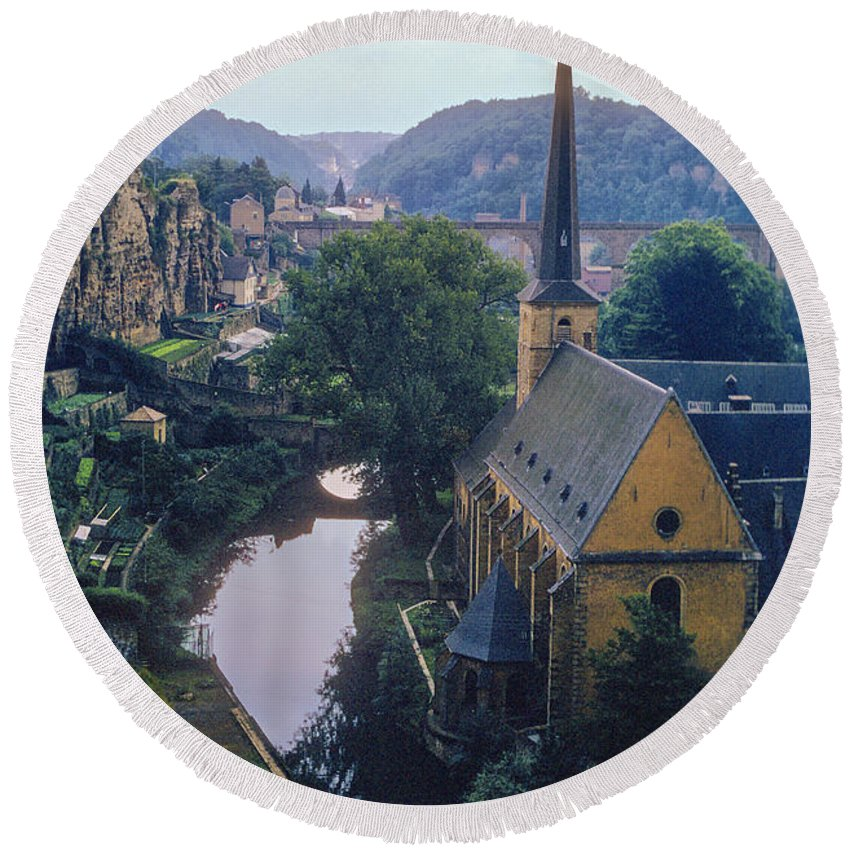 Luxembourg Mosel River Rivers Church Churches Place Places Of Worship St. Jean Du Grund Water Landscape Landscapes City Cities Cityscape Cityscapes Building Buildings Structure Structures Round Beach Towel featuring the photograph St. Jean Du Grund by Bob Phillips