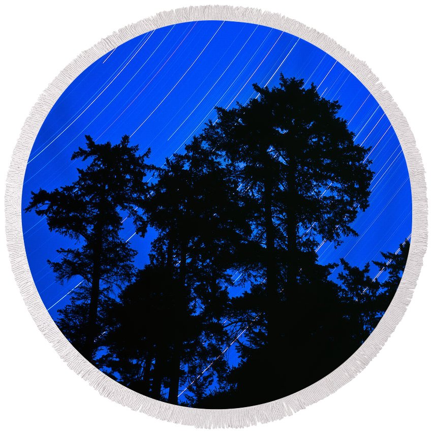 Star Trails Round Beach Towel featuring the photograph Star Trails Behind Ruby Beach Tree Group by Tim Rayburn