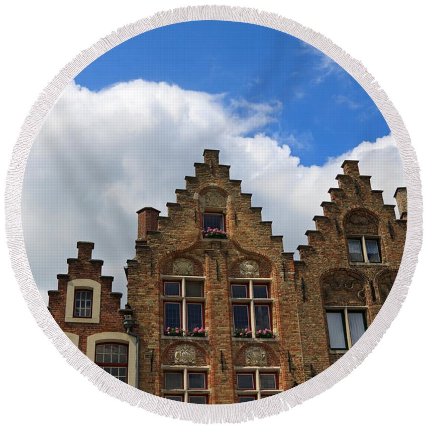 Gable Round Beach Towel featuring the photograph Stepped Gables Of The Brick Houses In Jan Van Eyck Square by Louise Heusinkveld