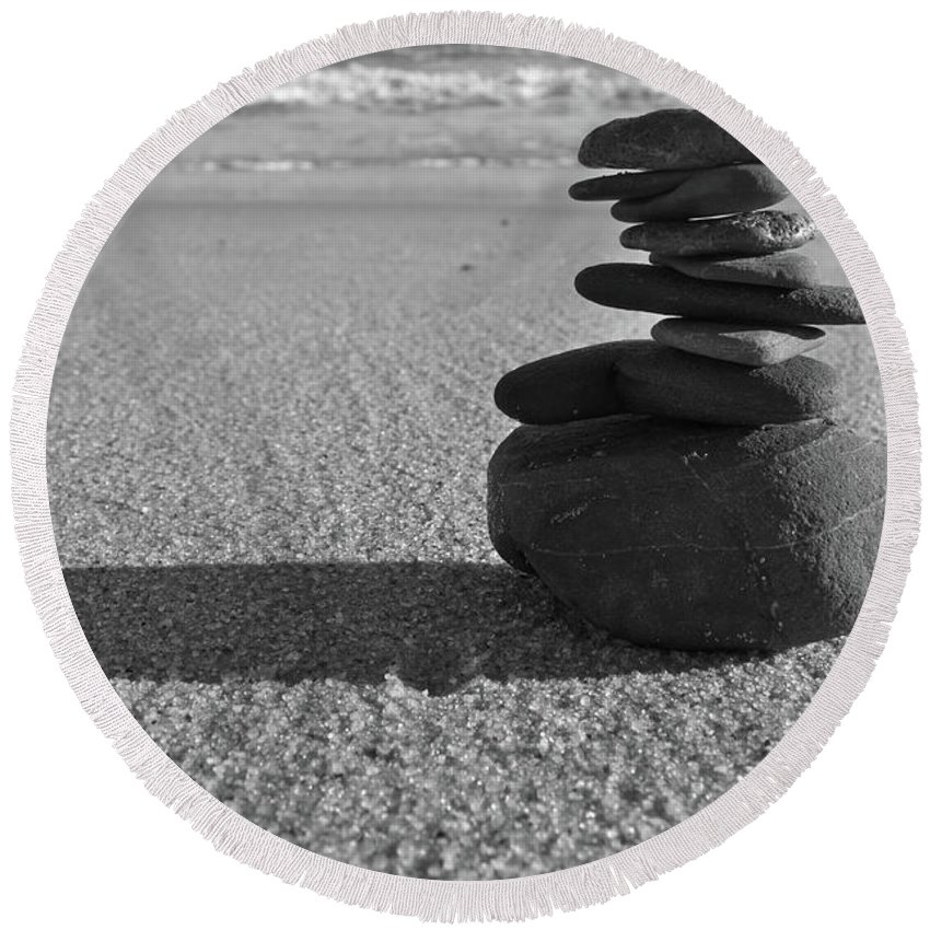 Balance Round Beach Towel featuring the photograph Stone Balance On The Beach In Monochrome by Angelo DeVal