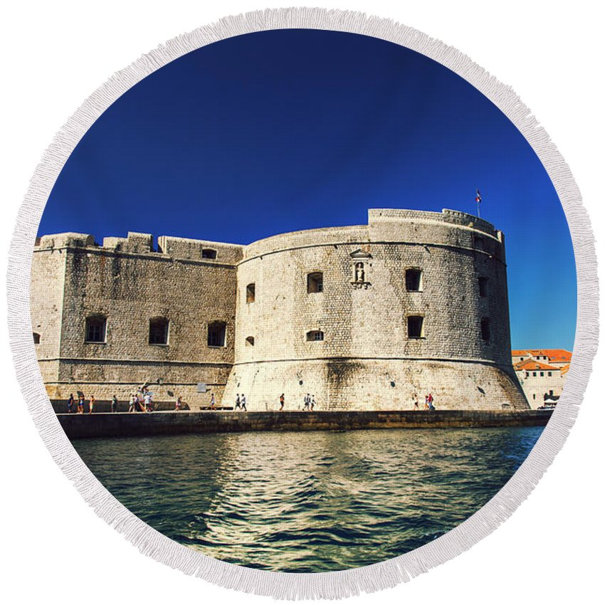 Adriatic Round Beach Towel featuring the photograph Stone Fortress In Dubrvnik King's Landing by Sandra Rugina