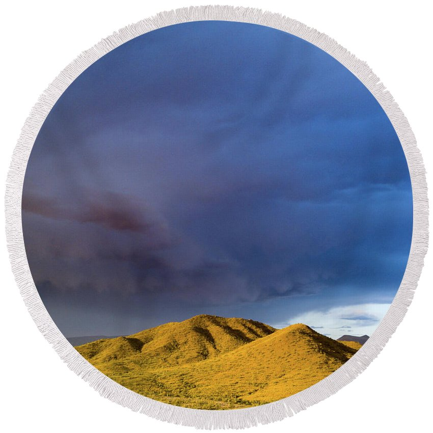 Drone Round Beach Towel featuring the photograph Storm Rolling Across Sun Dappled Mountains by David Stevens