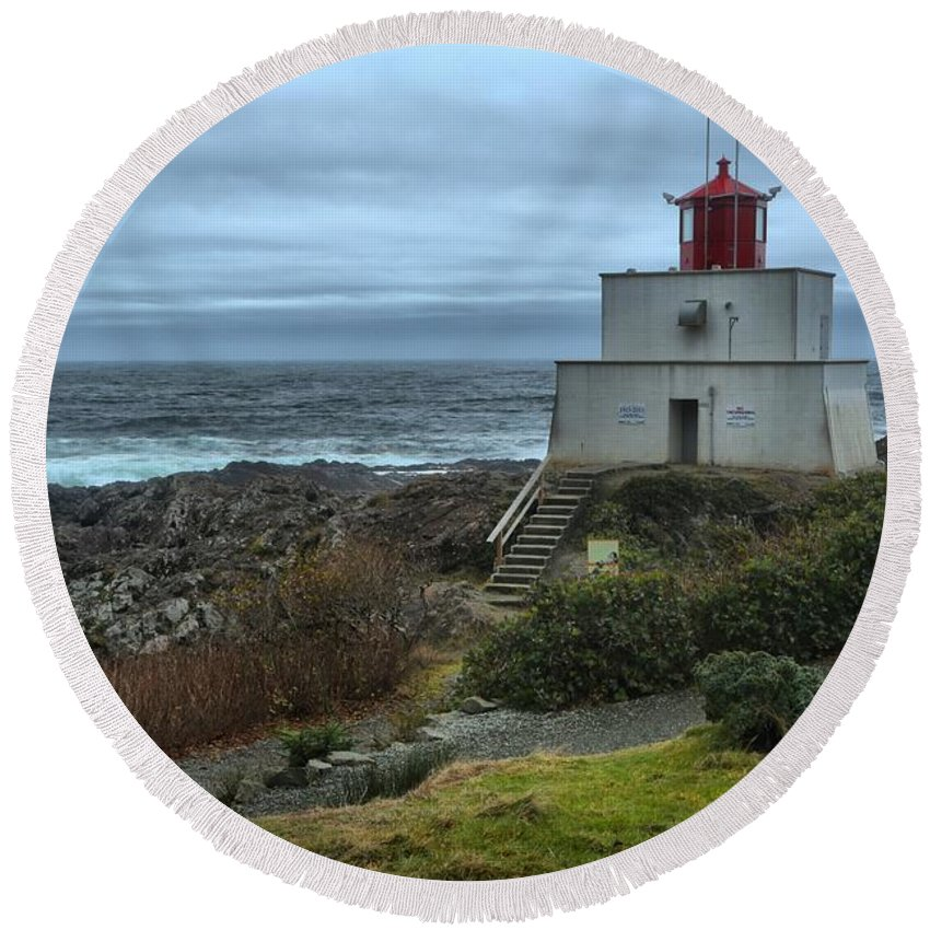 Amphitrite Lighthouse. Wild Pacific Trail Round Beach Towel featuring the photograph Stormy Skies Over Amphitrite by Adam Jewell